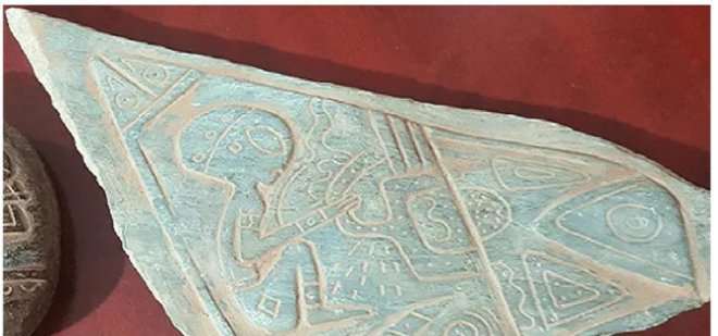 The Mexican stele with inscriptions and alien figures