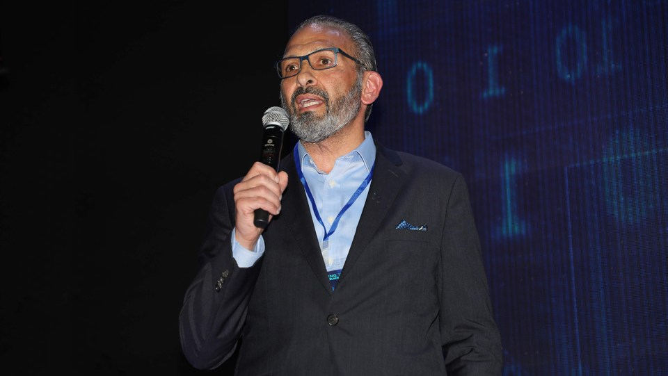 Frank Casale, founder of the Institute for Robotic Process Automation and Artificial Intelligence (IRPA AI), speaks at the launch event for the Digital Americas Pipeline Initiative (DAPI) in Medellín, Colombia. (Photo credit: IRPA AI)