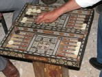 "Backgammon, one of the oldest classes of board games in the world, being played in the streets of the oldest city in the world. Excavations at Shahr-e Sukhteh (Persian شهر سوخته, literally ""The Burnt City"") in Iran have shown that the game existed there around 3000 BC."