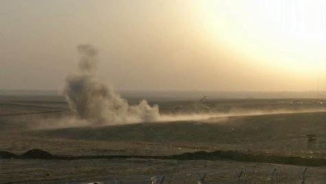 Smoke can be seen rising from the Khazer checkpoint outside the Kurdish capital of Erbil, where targeted airstrikes were authorized against Islamic radicals. Publish Date August 8, 2014. Image CreditUncredited/AP video, via Associated Press