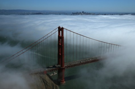 The north tower of the Golden Gate Bridge is seen surrounded by fog on September 8, 2013, in San Francisco. Photo by Justin Sullivan -Getty Images