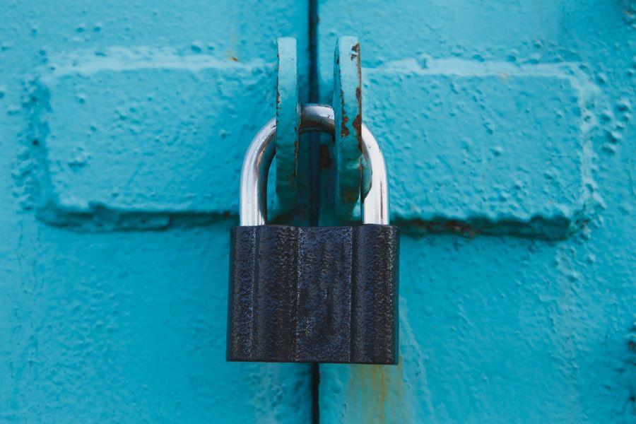 Padlock on blue door
