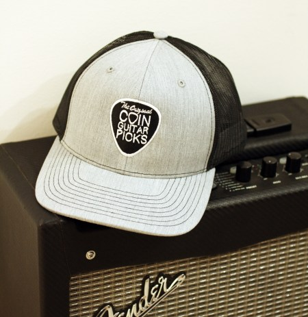The Original Coin Guitar Picks Hat on amp