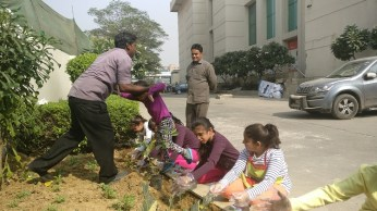 Go Green: Kids planting a sapling
