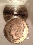 An example of a Morgan Dollar cut in half to match a date with a mintmark to have the coin appear something it is not.