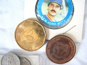 "Miscellaneous Items with Canadian dollar, dimes, a TBTA token, and Keith Hernandez souvenir ""coin."""