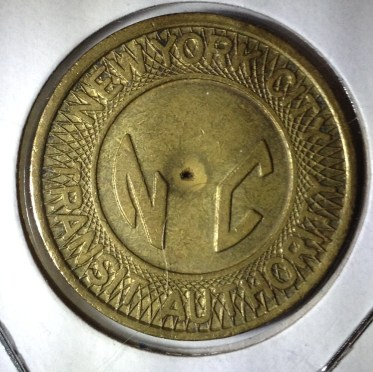 "New York City Type 2 Subway Token error. It's missing the punched out ""Y"""