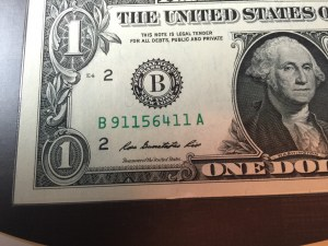 "Close up of the Series 2013 $1 FRN. Note that the serial number begins with ""911"""