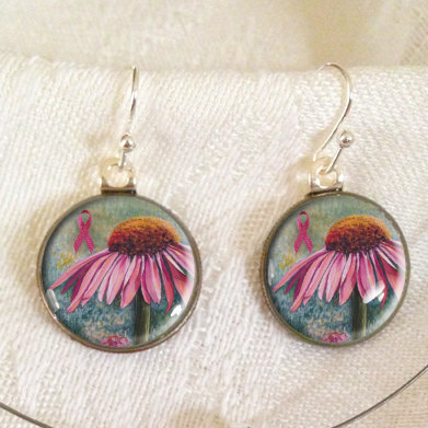 Resin ear rings made by InspiringFlowers using Roosevelt dimes