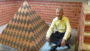 Cory Nelson and his coin pyramid