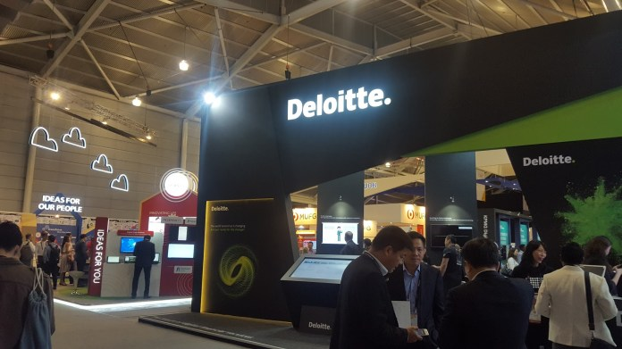 Corporate sponsor booths like Deloitte's take up the majority of exhibition real estate