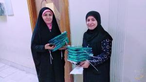 تدريسيتان من قسم الفقه واصوله تشاركان في تقديم هدايا بمناسبة عيد الام