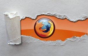 Se puede ver el logotipo de Firefox (el zorro rojo en torno a la bola del mundo) aparecer de detrás de un papel rasgado de color gris