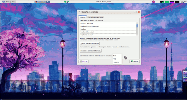 Imagen de un escritorio GNU/Linux con la ventana de configuración de idiomas y el desplegable con las opciones de método de entrada, entre las que se ve