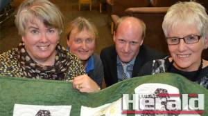 Heather Green, left and Judy Pyke, far right, presented Vicki Cronin and Jonathon Hay from Mercy Place with a quilt the Colac Quilters finished after 40 years.