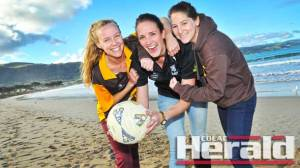 Star Lorne netball recruit Brooke Hutchings, centre, is a primary school teacher at Apollo Bay P-12 College with Apollo Bay's Katie Monaghan, left, and Cara Hudson. Sunday's A Grade netball elimination final will have a coastal theme with Hutchings' Dolphins set to take on her workmates and the Hawks at Colac's Central Reserve.