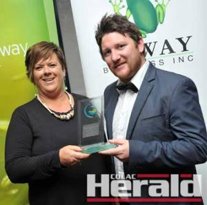 Western District Employment Access Colac manager Trudi Perkins presented the Colac Herald's advertising manager Jake Veale with this year's Employee of the Year award at the Powercor Colac Otway Business Awards.
