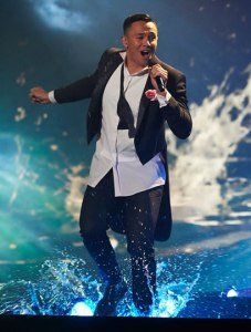 Cyrus Villanueva, grandson of Colac's Nola and Alan Gray, splashes around on stage during his The X-Factor performance last week. PICTURE: SEVEN NETWORK