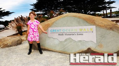 Townsville tourist Sydney Mayer poses by the masthead at the start of the Great Ocean Walk at Apollo Bay. The walk is expected to be a popular tourist drawcard over summer.