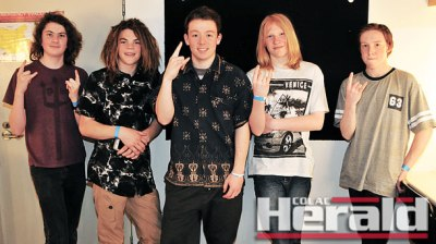 Apollo Bay teen rockers The Refuge, from left, Jackson Hayat, Houston Walters, Noa Matthews, Riley Newton and Leon Kennedy are launching their debut album Jet Stream with a performance at Apollo Bay RSL on Saturday night.