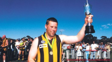 CLUB LEGEND: Apollo Bay will host a Bryan Noseda Celebration Day next month to remember the beloved Hawk who is the coastal club's games record holder. Noseda is pictured holding aloft the 2002 reserves premiership cup.
