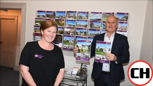 SURGING: Colac to Coast Real Estate's Andrea Invermee says confidence in industry and living conditions have driven a boom in house prices in the Colac district. She is pictured with the agency's Stuart Nelson.
