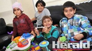 Iranian asylum seekers Hasti, 5, Darya, 7, Elia, 8, and Elia, 8, play with toys donated by Colac and district families.