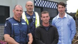 Leading Senior Constable Colin Cooper, Senior Constable Ray Doensen, and Apollo Bay surf lifesavers Quinn Matthews and Jake Cooper.