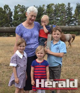 Judy Billing, who records rainfall at her family's dairy farm west of Colac, is pictured with grandchildren Henry  and Biddy, Bella and Tom.