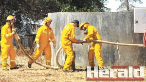 Firefighters prepare to battle a fire at Stonyford.