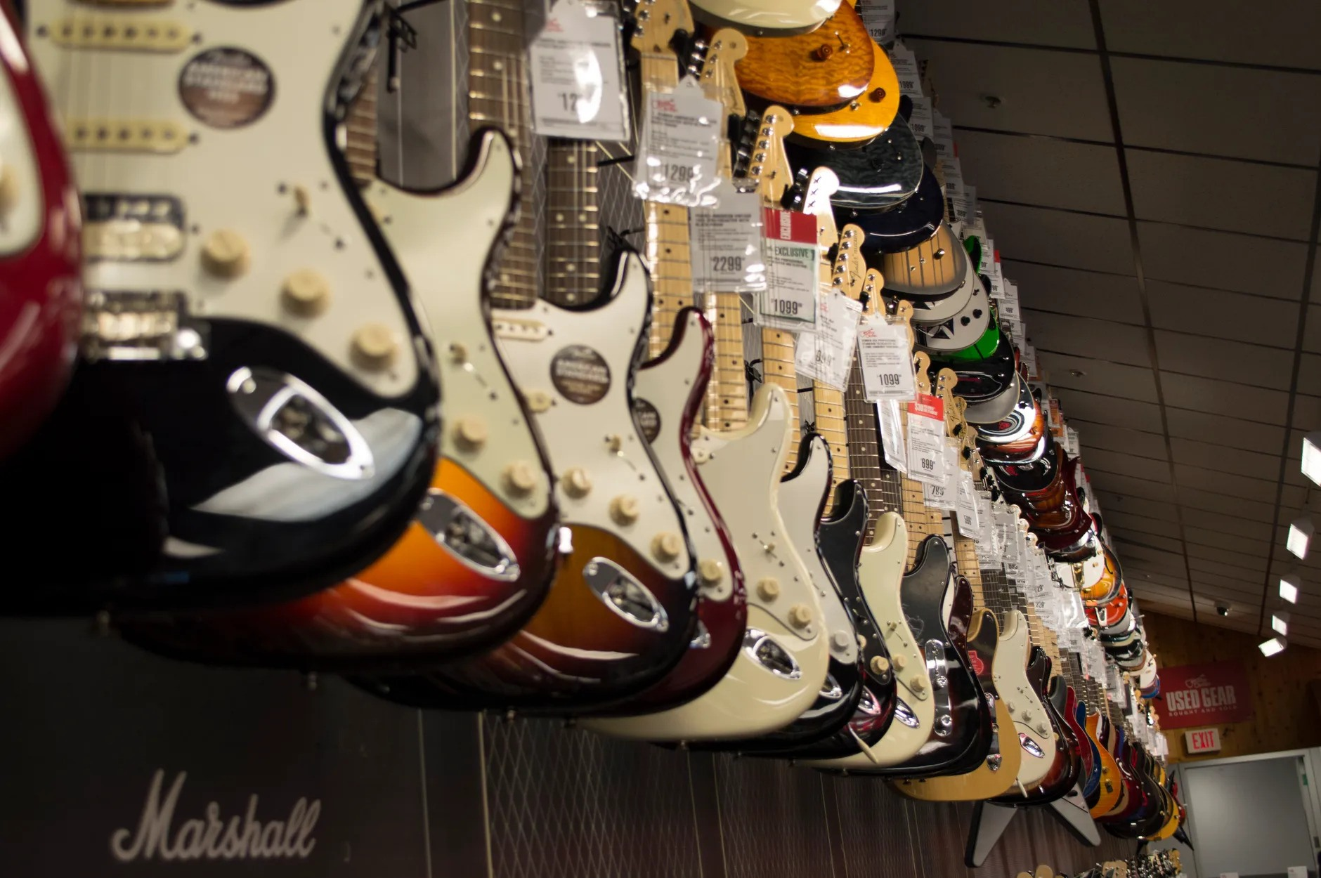 guitars hanging guitar store