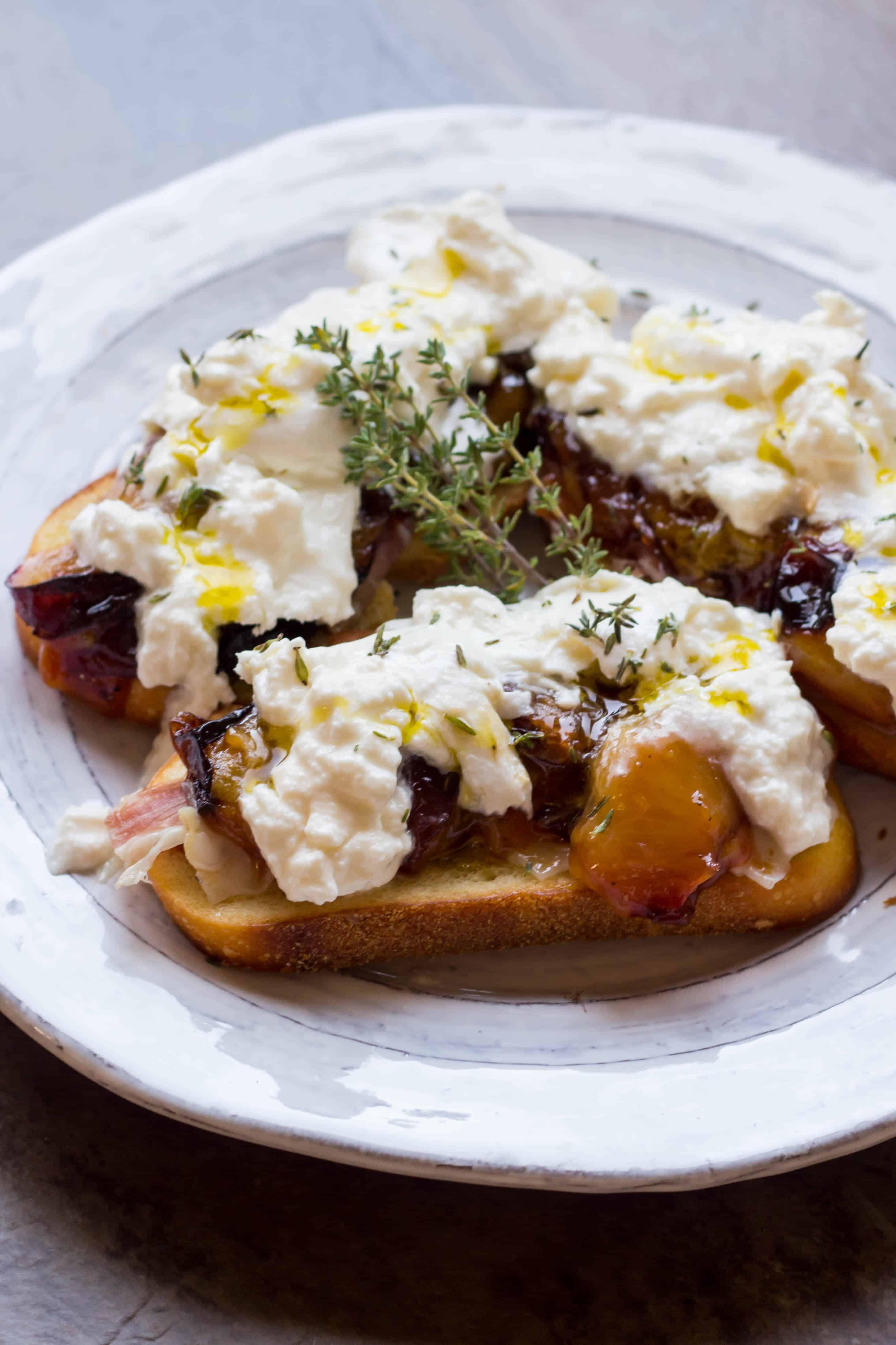 Honey Roasted Plum Crostini with Burrata and Prosciutto (Video!)
