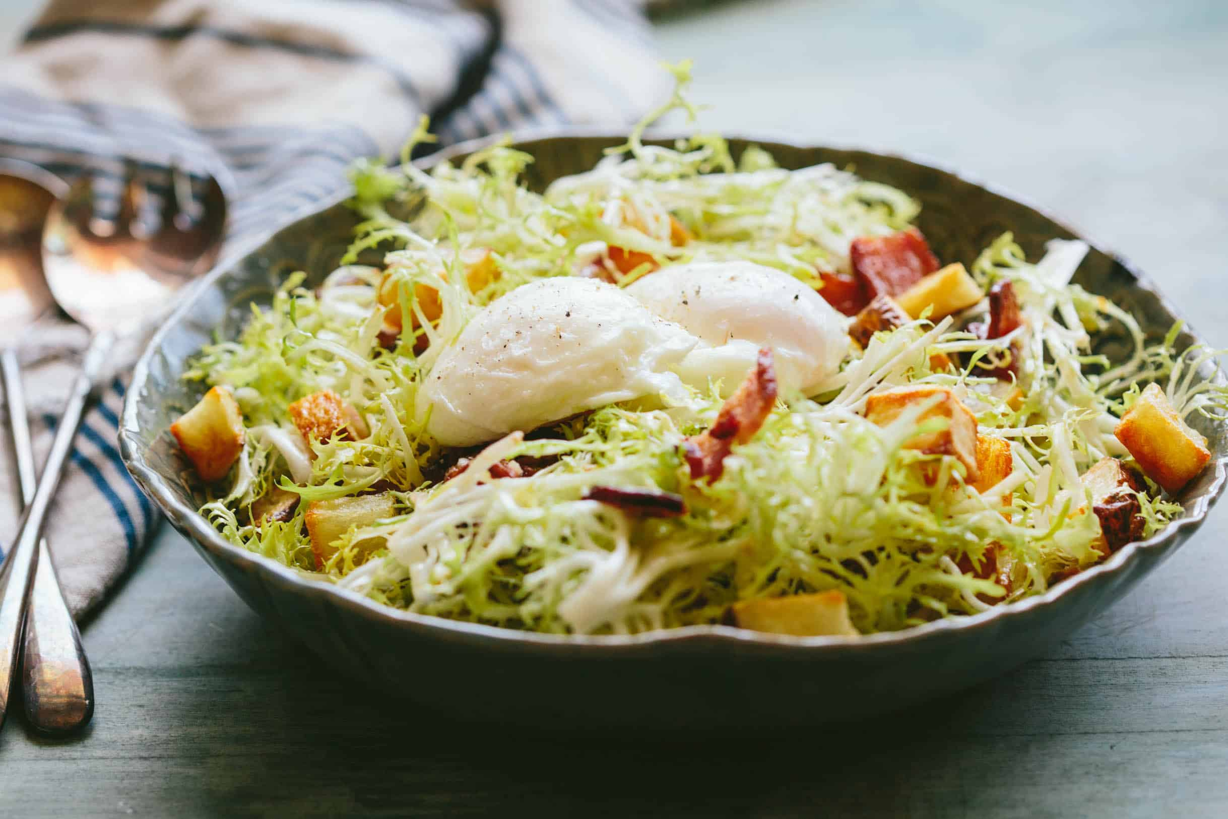 This classic recipe for Lyonnaise Salad is an easy and delicious salad that's filling enough to have as a meal. #french #lyonnaise #poached #eggs #salad #recipe | ColeyCooks.com