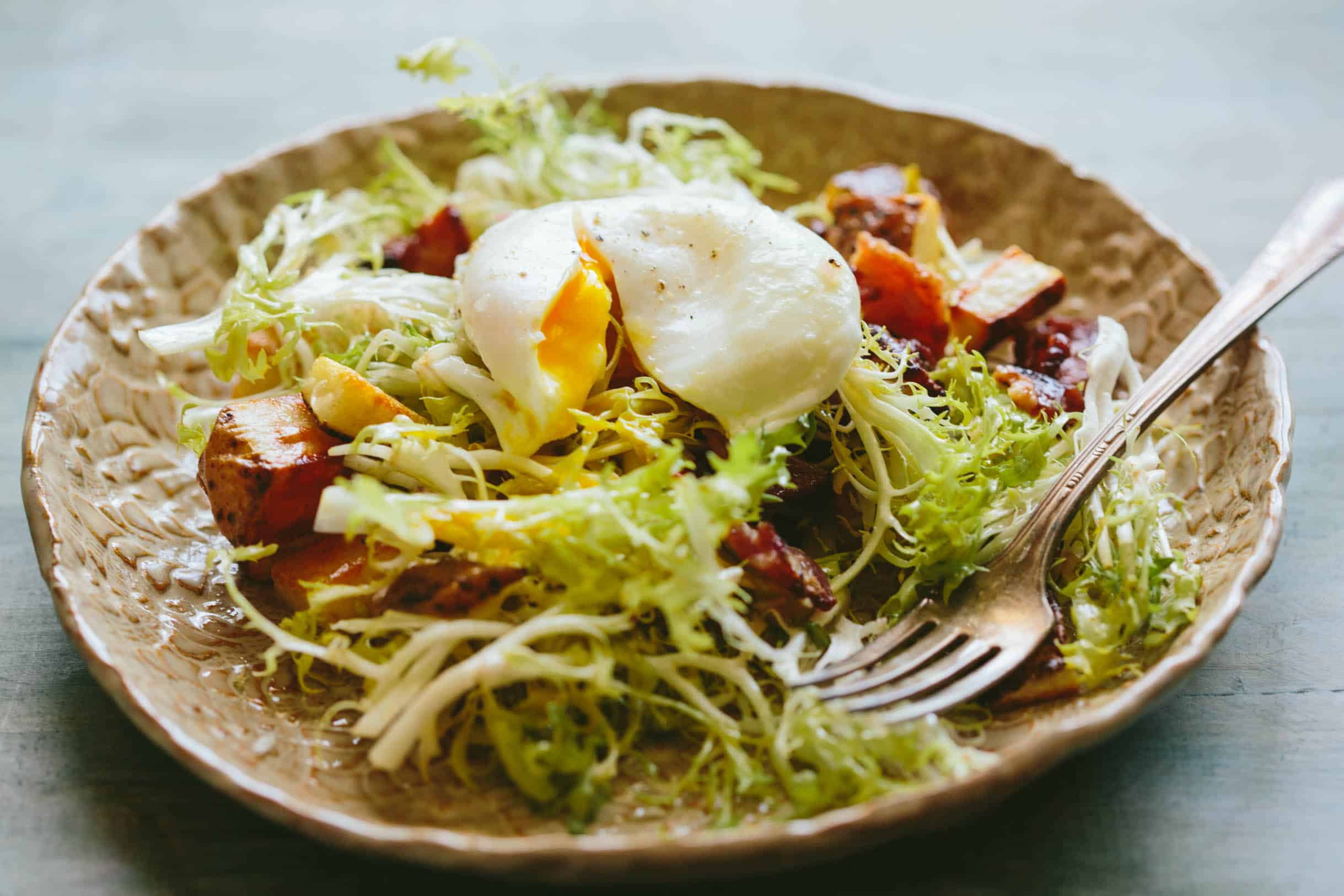This classic recipe for Lyonnaise Salad is an easy and delicious salad that's filling enough to have as a meal. #french #lyonnaise #poached #eggs #salad #recipe   ColeyCooks.com