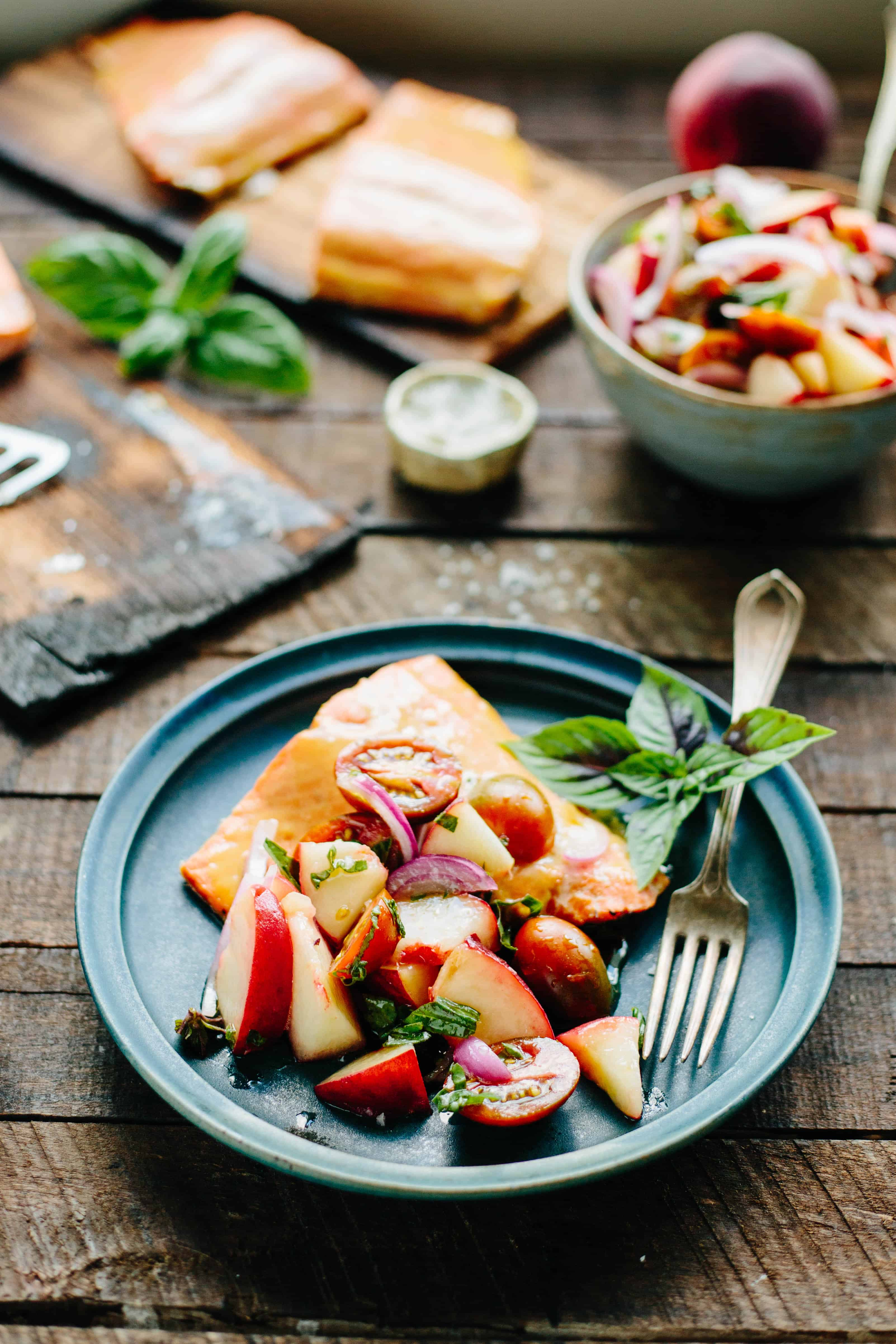 CEDAR PLANKED SALMON with Peach + Tomato Salsa | Delicious wild salmon with a Dijon glaze, cooked over smoky cedar planks and finished with a light and bright summer salsa! #sockeye #salmon #easy #recipe #peaches #tomatoes #cedarplank | ColeyCooks.com