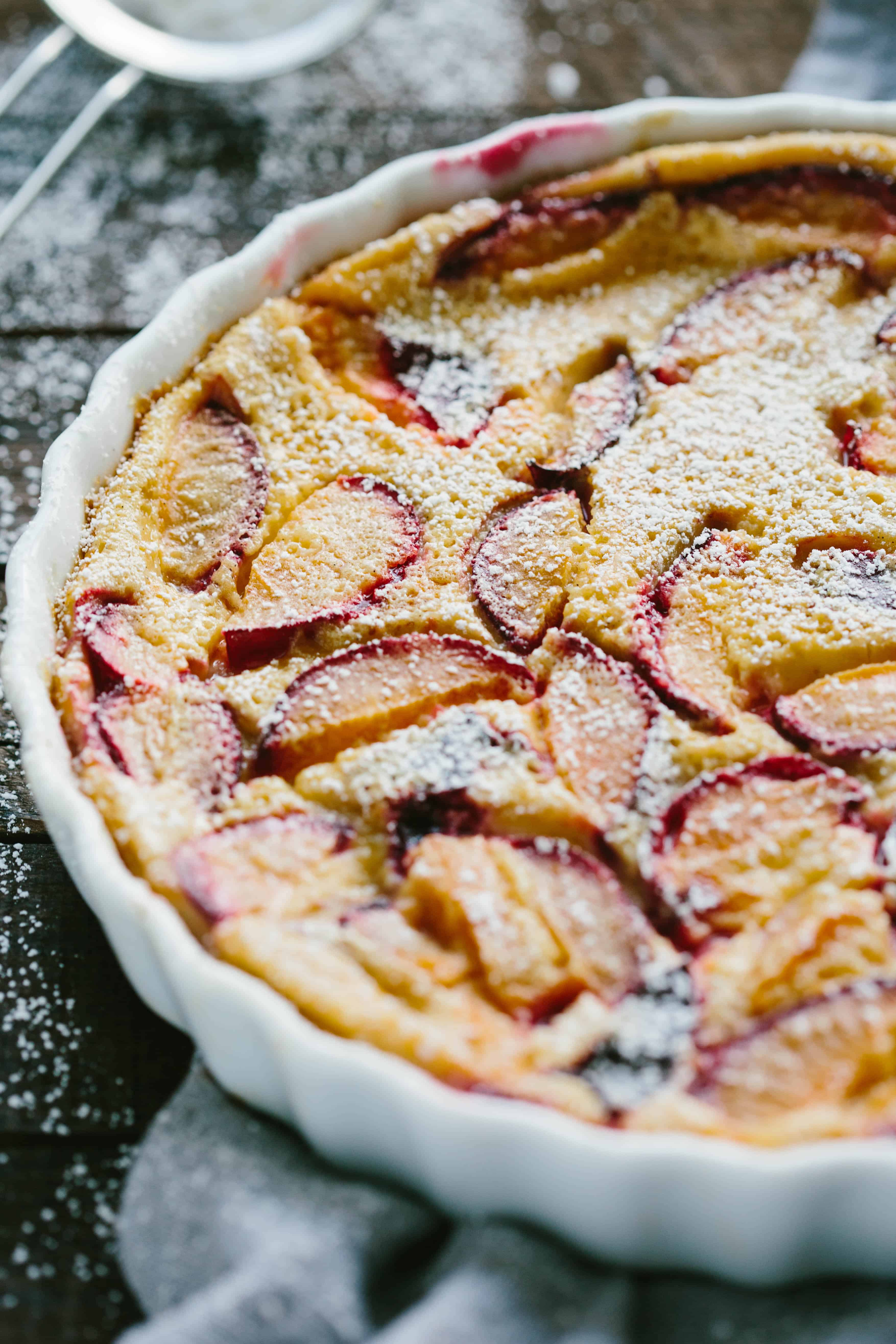 BROWN SUGAR PLUM CLAFOUTIS   This easy and elegant classic French dessert is silky, custardy, and full of juicy fresh plums. #french #dessert #easy #fruit #custard #elegant #egg #clafoutis #plums #recipe   ColeyCooks.com