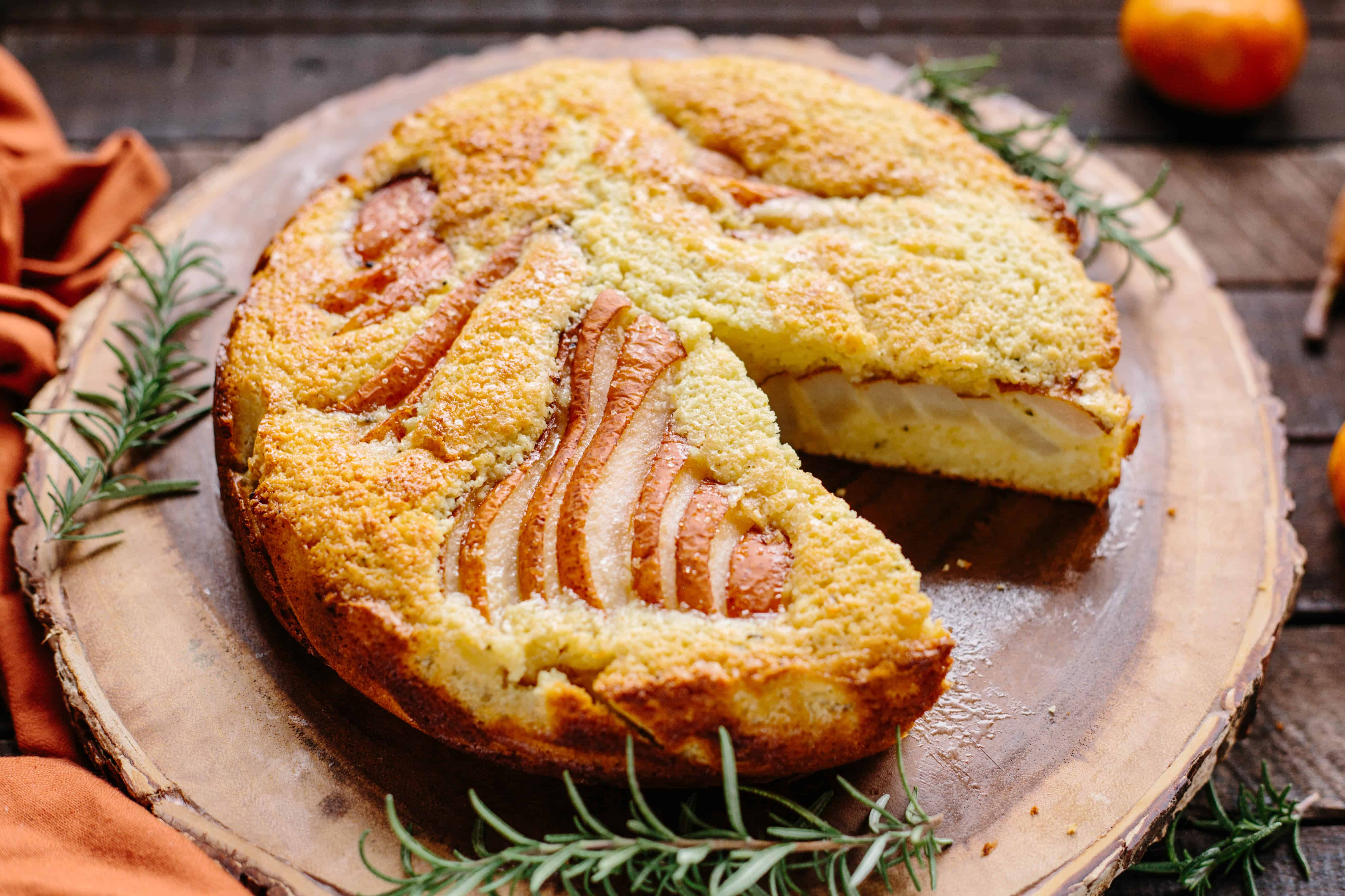 Ricotta + Pear Cake   This beautiful fall cake is made with fresh ricotta and pears, scented with orange and rosemary and makes a perfect Thanksgiving dessert! #thanksgiving #recipe #pear #ricotta #cake #dessert #rosemary #orange #easy   ColeyCooks.com