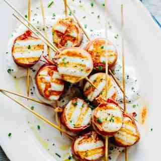 overhead shot of platter of grilled scallops wrapped in bayonne ham and horseradish cream