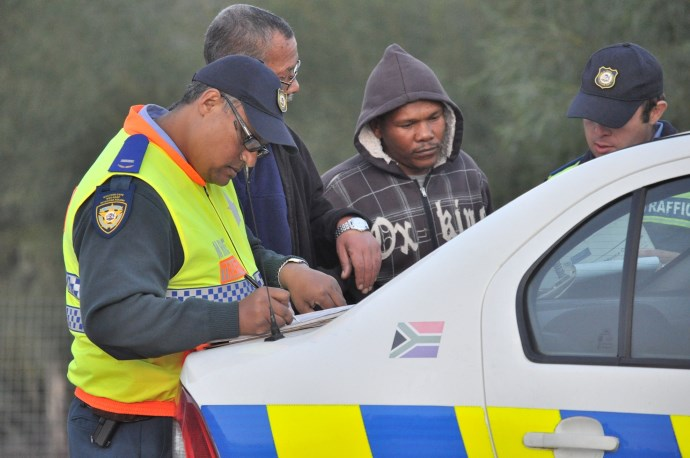 Provincial Traffic Inspector Marlon Rhode issues a fine to a transport operator