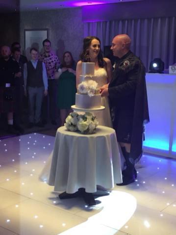 Ingliston Connemara suite spot light cake cutting