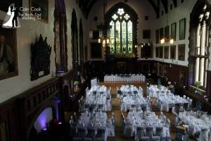 A daytime photo of Durham Castle ready for a wedding. Moodlighting in Purple, Master of Ceremonies set up and music ready to go.