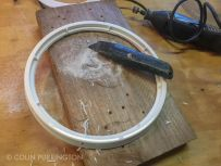 Cut hole in pail lid with Dremel, then smooth the cut with a knife.