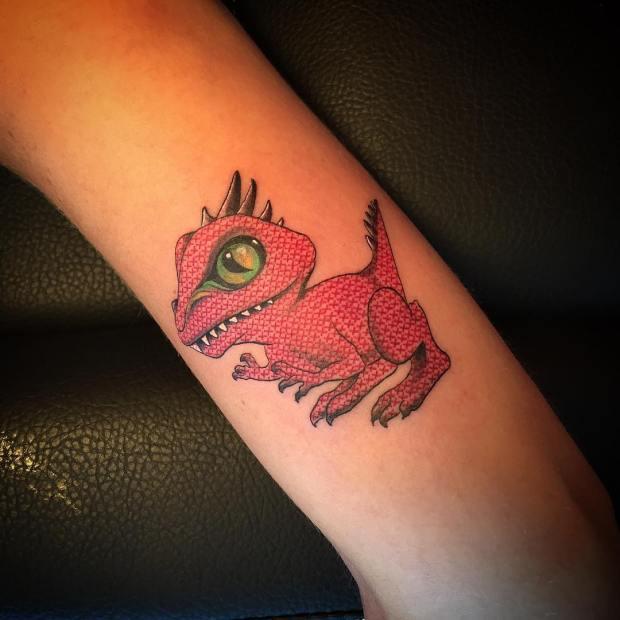 Tatuaje punto de cruz de Eva Krbdk Dinosaurio