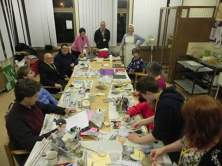 Rachel watches participants from the BUILD charity get stuck into making workhouse spoon dolls