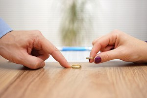 56812641 - husband and wife are returning wedding rings,divorce concept