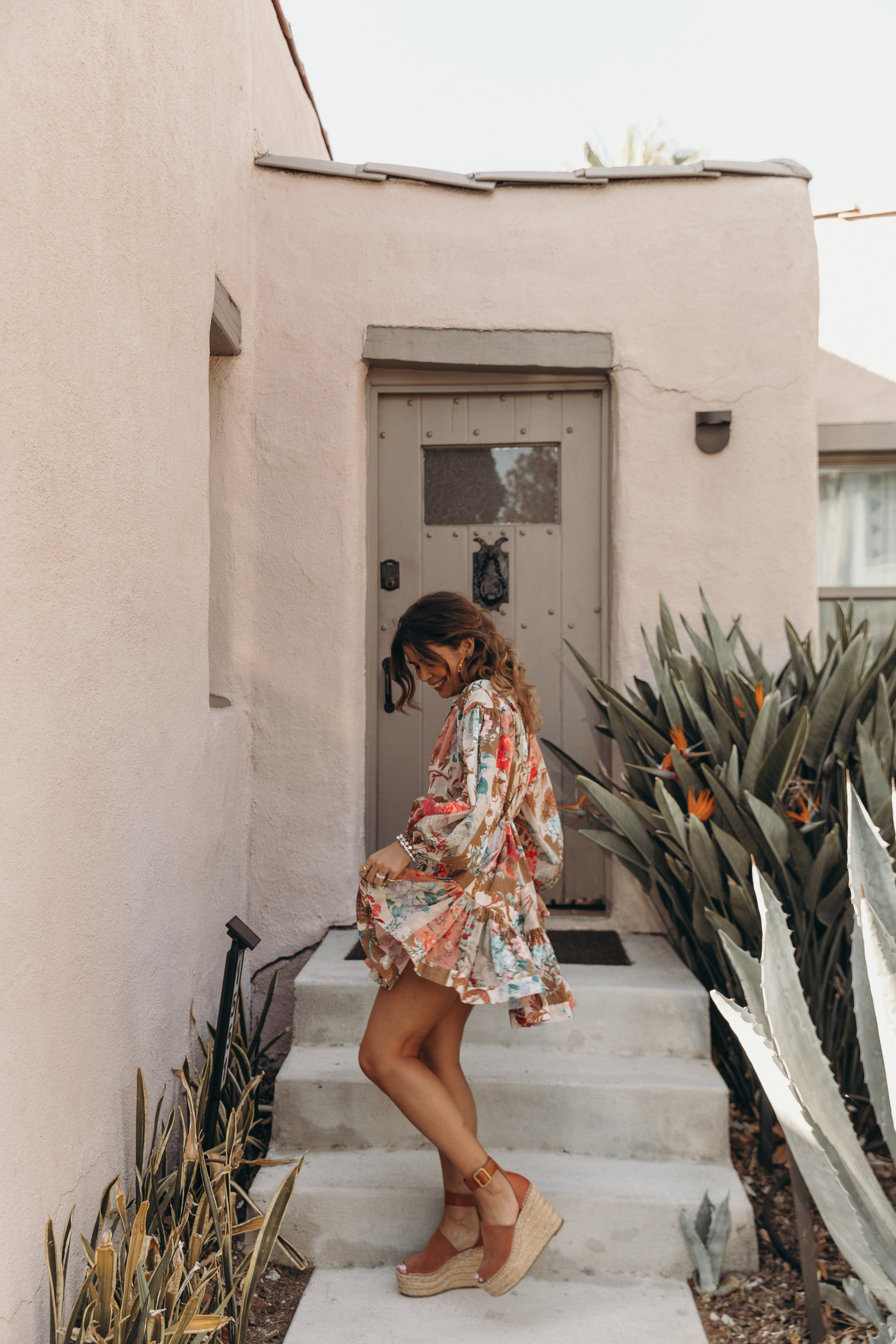 Sara from Collage Vintage is wearing a Zimmermann mini dress, See by Chloé wedged sandals and Loewe crossbody bag