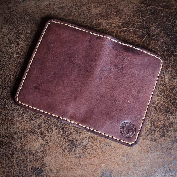 Front and back of Whinlatter handmade leather wallet flatlay