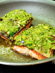 Fillets of pan fried salmon are smothered with a wonderful Caribbean inspired green seasoning made with cilantro, ginger, garlic and lime juice.