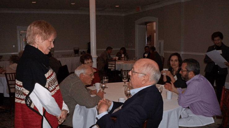 Several conversations at once at the Dec. 10, 2018, Retired Faculty Luncheon