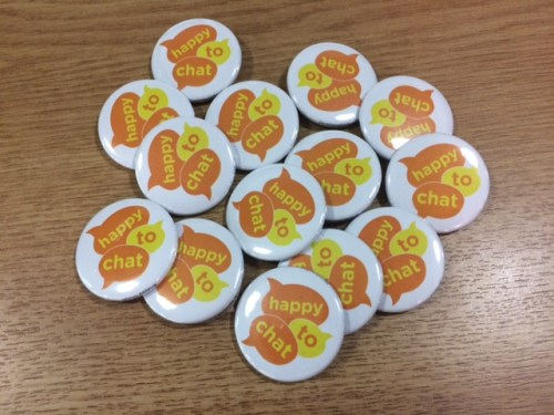 Badges that say 'happy to chat'
